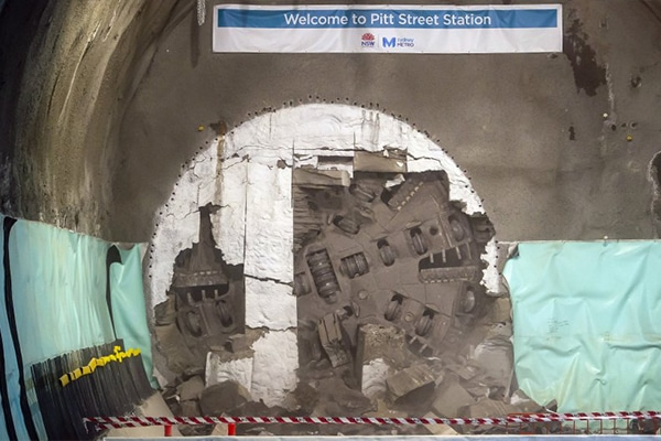 The first tunnel boring machine (TBM) has broken through at the future site of Pitt Street Station, 20 metres below the streets of Sydney.