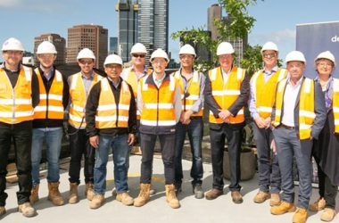 John Holland has reached a major milestone in the construction of its new headquarters, topping out the building on Melbourne's Flinders Street.
