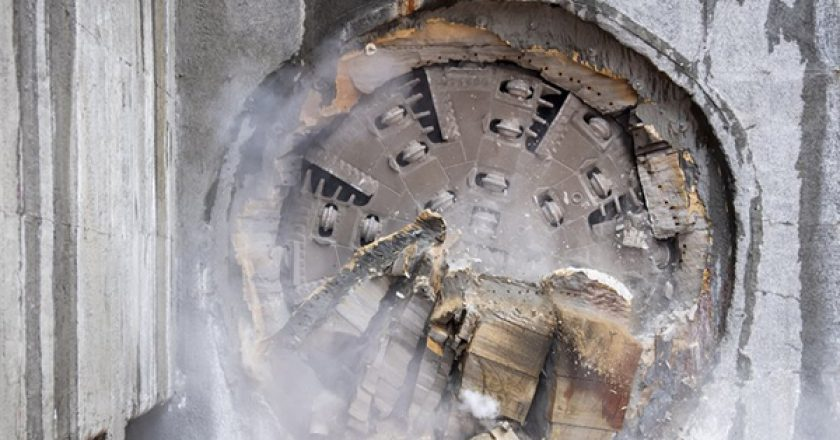 The first tunnel boring machine (TBM) to begin excavating under the centre of Sydney has finished its journey and broken through at the future site of Barangaroo Station.