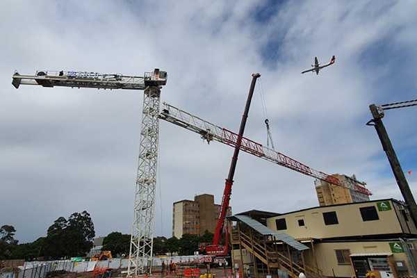 Construction has ramped up at the site of the $90 million Qantas Group Flight Training Centre, following the installation of a tower crane.