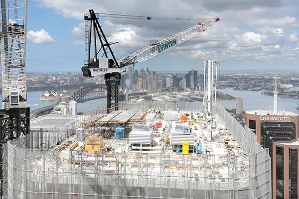 Construction workers have hit a key milestone on a $1.2 billion commercial office building in North Sydney, topping out the tallest building in the region.