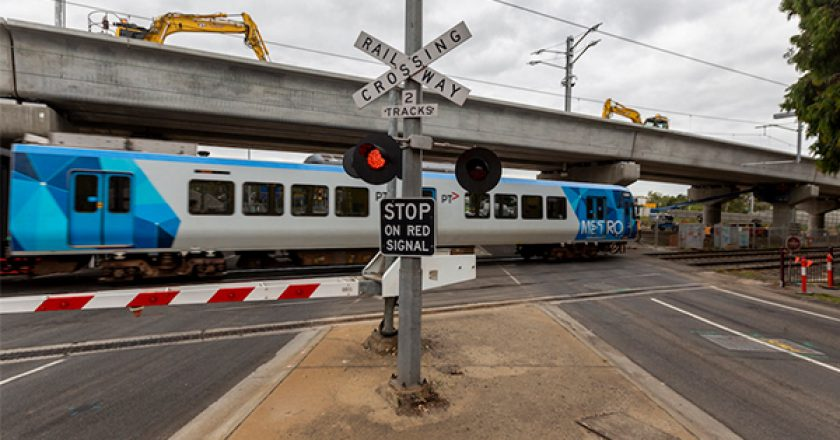 One of Victoria's most congested level crossings has been officially removed, with trains travelling over a new rail bridge at Toorak Road for the first time.