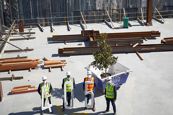 Construction has topped out on the $900 million office and retail development 405 Bourke Street, Melbourne, despite strict COVID-19 restrictions reducing the site's workforce.